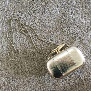 Women's DVF metallic gold crossbody clutch bag